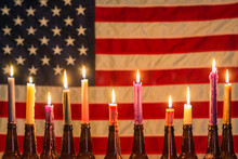 American Flag Illuminated By A Row Of Candles In Beer Bottle Holders