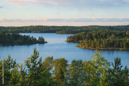 Summer evening landscape from the high shore of Ladoga lake in the skerries to t Fototapet