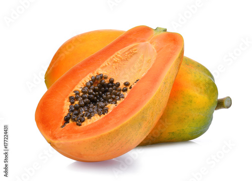 whole and half of ripe papaya fruit with seeds isolated on white background