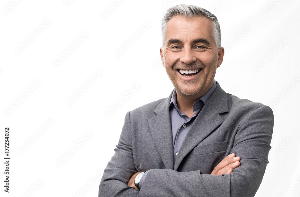 Fototapeta Confident businessman posing with arms crossed