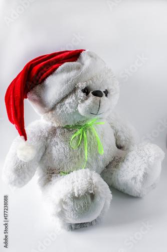 7a2bc2f1bce96 Toy teddy bear wearing Santa hat