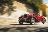Red vintage car at sunset - 177244444