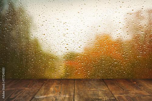 Table on rainy window background Canvas Print
