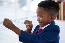 Side View Of Boy Playing With Rubber Band