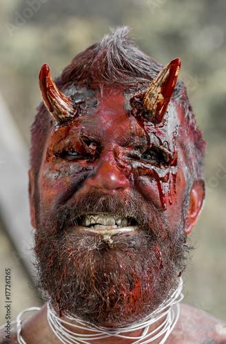 Halloween demon man with beard showing teeth Poster