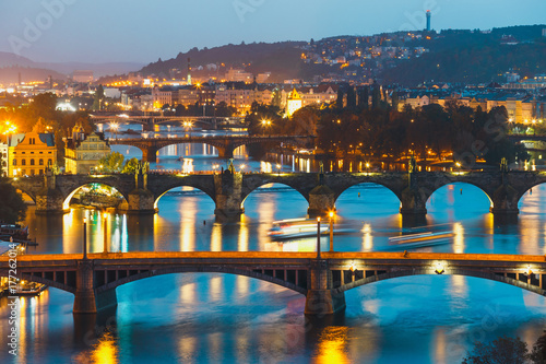 Poster Prague View of bridges with historic Charles Bridge and Vltava river at night in Prague, Czech Republic