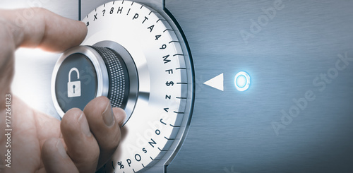 Fototapeta Hand turning a safe lock dial with numbers, punctuations, letters and symbols. Concept of Safe and secured password generation.  obraz