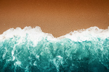 Wave Of Teal Ocean On Sandy Be...
