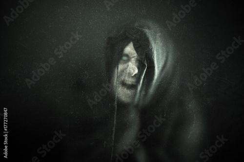 Vászonkép Angry ghost figure in the dark