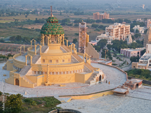 Poster Temple Jain temple at the foot of Shatrunjaya Hill at Palitana, India. The buildings' steps indicate that making an ascent to a holy place is central to Jainism