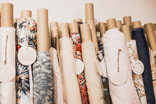 Rolls Of Natural High Fashion Fabrics And Textiles. Sewing Industry Concept