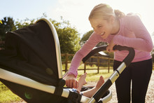 Mother Exercising By Running W...