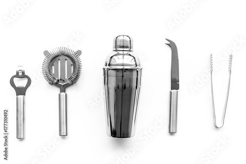 Fotografia  Barman equipment. Shaker, strainer on white background top view