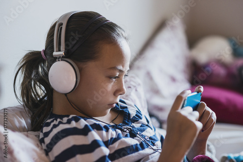 Preteen Girl With Electronic Device
