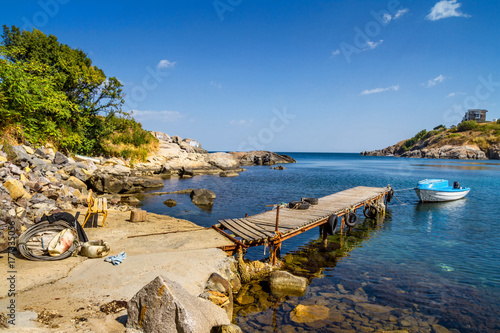 Foto auf Gartenposter Stadt am Wasser Coastal landscape - the wooden pier and boats in rocky bay, near city of Sozopol on the Black Sea coast in Bulgaria