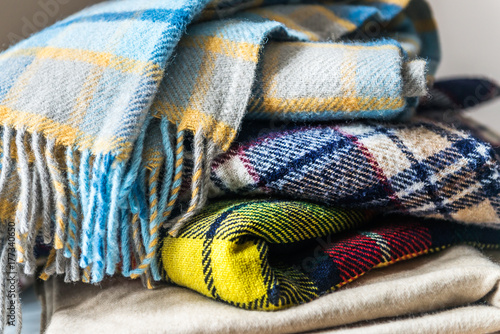 Obraz Stack of woolen checked blankets - fototapety do salonu