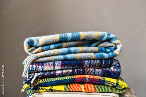 Photo  Stack of woolen checked blankets