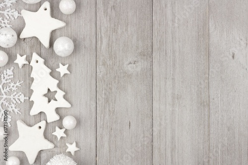 christmas side border with shabby chic handmade clay ornaments on a rustic gray wood background - Handmade Shabby Chic Christmas Decorations