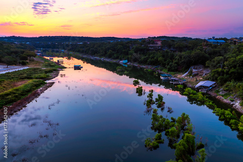 Poster Texas The sun rises behind the Pedernales River in the Texas hill country