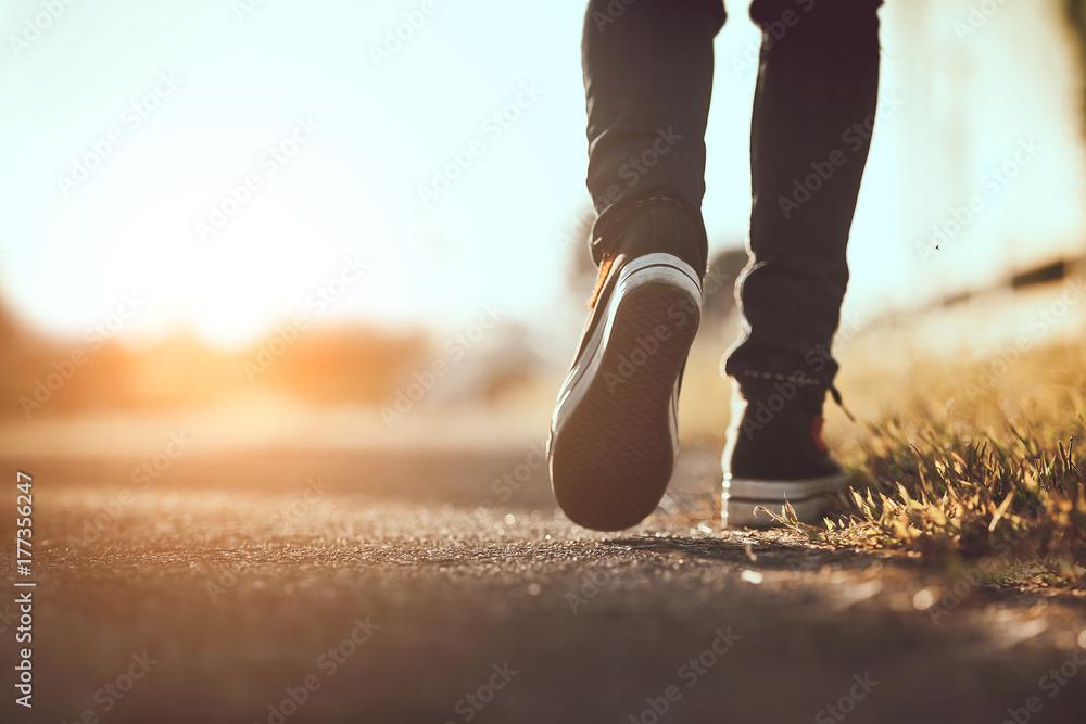 Fototapeta Close up of girl shoes walking