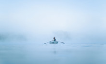 Mystical Woman In Row Boat On A Foggy New England Morning