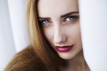 Young Woman With Green Eyes And Red Lipstick