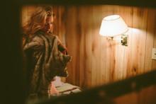 Blonde Woman Draped In Fur, Cozy In Warm Cabin