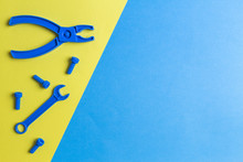 Toys Background. Kids Construction Toys Tools On Blue And Yellow Background. Top View