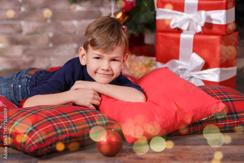 Handsome cute boy celebrating New Year Christmas alone close to xmas ...