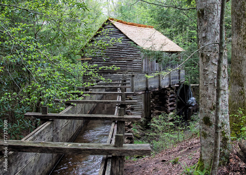 Photo  Historic gristmill with water wheel