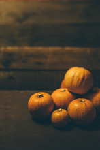 Bunch Of Pumpkins On Wooden Ba...