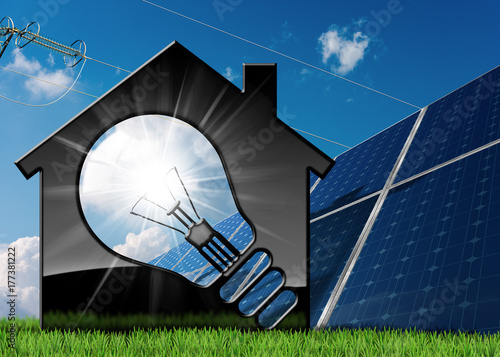 Model House with Light Bulb and Solar Panels - Buy this stock photo
