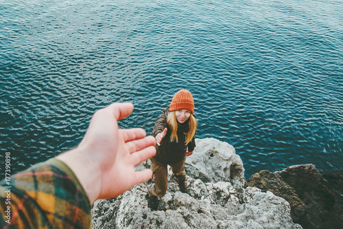 Couple Man and Woman help giving hands Love and Travel Lifestyle concept. Young family vacations at sea outdoor