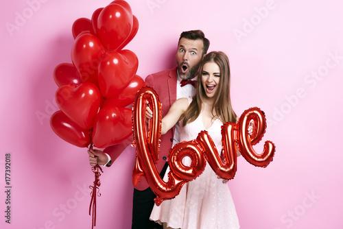 Fototapeta  Man with balloon embracing his girlfriend.
