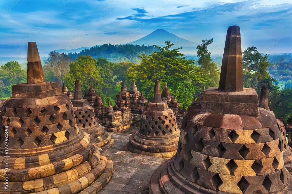 Fototapeta Candi Borobudur in the background of rainforest, morning mist and Sumbing Mountain. Candi Borobudur, Yogyakarta, Jawa, Indonesia.