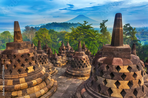 Candi Borobudur in the background of rainforest, morning mist and Sumbing Mountain. Candi Borobudur, Yogyakarta, Jawa, Indonesia.