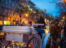 Family Horse Carriage Ride Through Decorated City