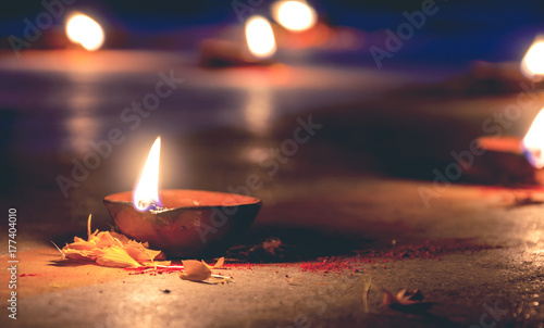 background of diya or oil lamp lighted especially occation of diwali or deepawal Fototapeta