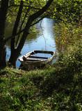 Fototapeta Na sufit - Flooded boat