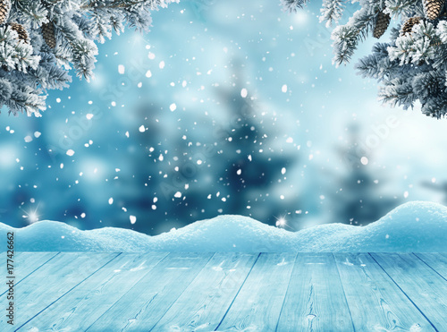Photo sur Aluminium Bleu clair Merry christmas and happy new year greeting background with table .Winter landscape with snow and christmas trees