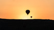 silhouettes of hot air balloons in Cappadocia, Turkey