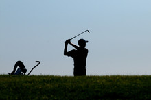 Silhouette Man Playing Golf At...