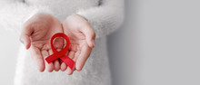 Red Ribbon On Woman Hands For ...