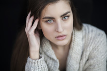Young Beautiful Woman With Brown Hair On A Black Background