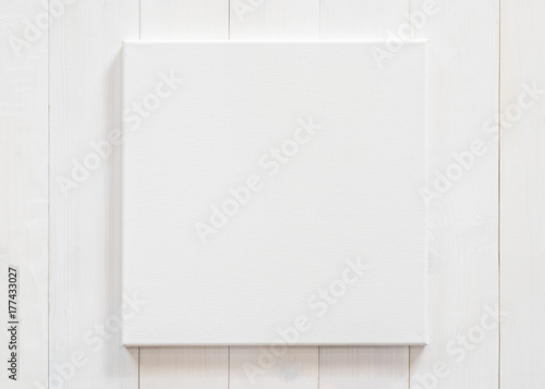 Fotografie, Obraz  White canvas frame mock up template square size on white wood wall for arts pain