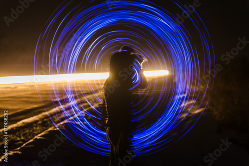 Photographie  blur or defocuset abstract pgoto of artistic light on long exposure with a girl