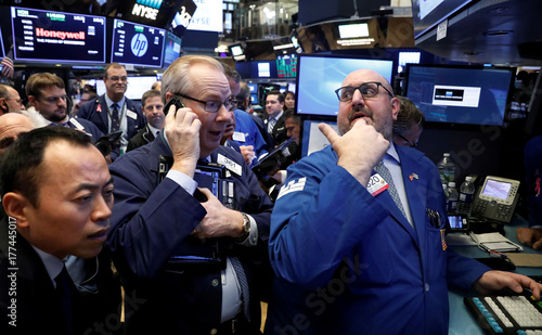 Traders gather for the IPO of Singapore-based Sea Limited on