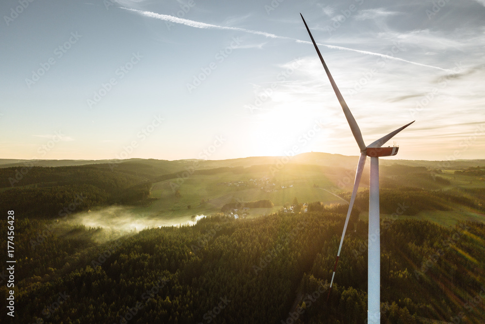 Fototapety, obrazy: Wind Turbine in the sunset seen from an aerial view