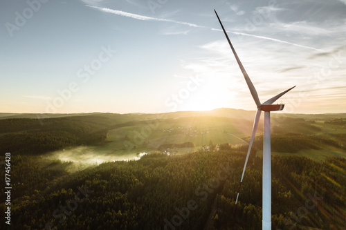 Fotografia  Wind Turbine in the sunset seen from an aerial view