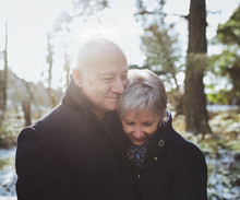 Happy Older Middle Aged Couple (fifties) Enjoying Each Other - Snuggling - Outside In Winter
